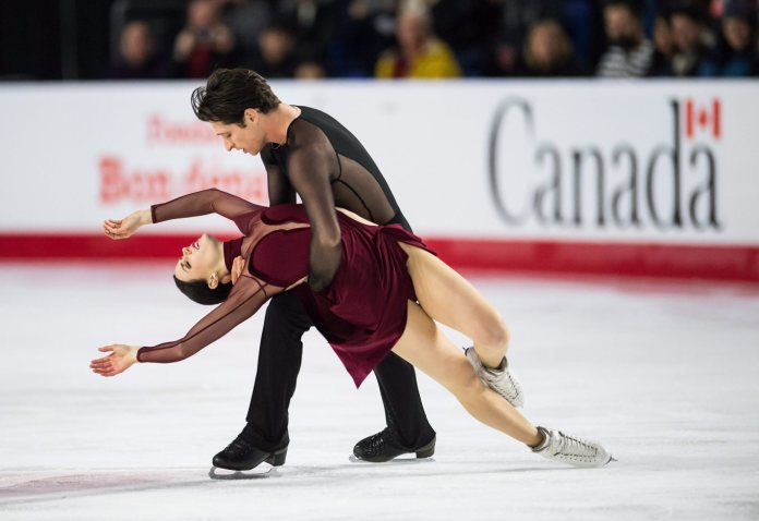 Tessa Virtue, front, and Scott Moir perform their free dance during the senior ice dance competition at the Canadian Figure Skating Championships in Vancouver, B.C., on Saturday January 13, 2018. THE CANADIAN PRESS/Jonathan Hayward